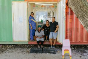 teachers standing together in front of the classroom container